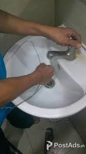 repairing a clogged sink