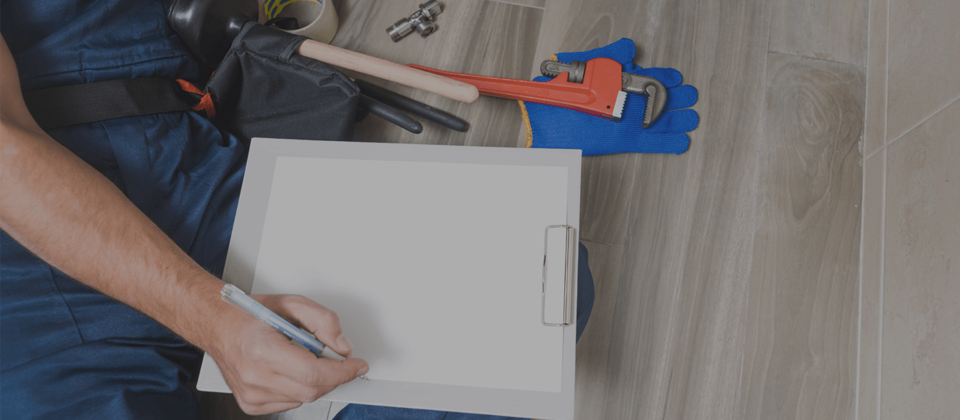 plumber holding pen and paper